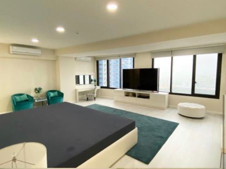 2 Floor Penthouse unit  with a sweeping view of the city.