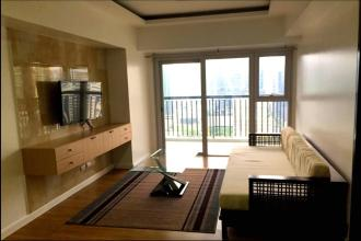 Fully Furnished 1BR with Balcony  at One Maridien BGC